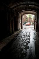 First gate into courtyard of apartment buildings, Brzeska street, Praga district, Warsaw, Poland, Europe.