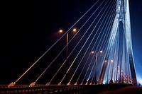 Swietokrzyski bridge illuminated at night, Warsaw, Poland, Central Europe.