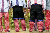 Close-up on the famous red and white striped trousers and traditional jacket in Todos Santos Cuchumatan, Guatemala, Central America.