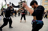 Shia Muslims flagellate themselves during street procession in the Day of Ashura, tenth day of Muharram and commemoration of Husayn ibn Ali´s death, M...