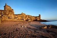 St Andrews Castle and Castle Sands at Sunrise St Andrews Fife Scotland.