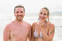 Close up of young man and woman couple smiling happily after swimming in the ocean. Riviera Nayarit, Pacific Coast, Mexico.