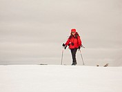 A woman, 67, skiing in the mountains of Wells Gray Provincial Park in British Columbia, Canada.