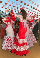 April Fair, Young women dancing with the traditional flamenco dress, Seville, Region of Andalusia, Spain, Europe.