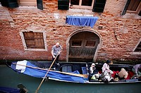 Italy, Venice, gondolas carrying tourists on the canals.