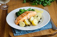 Baked salmon with mustard and caper potatoes.
