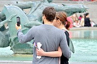 London, England, UK. Young couple in Trafalgar Square taking a selfie.
