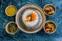 Nepal, Kathmandu, Swayambhunath. A Nepalese Lunch: rice, curried vegetables, chicken, spinach, lentil sauce.