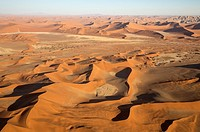 Sand dunes in the Namib Desert. Top right the Witberg (White Mountain, 426m), a granite massif in the centre of the Namib Desert. The trees are Camelt...