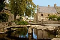 Brook in Vauville village, with bridge , Vauville, Cotentin, Normandy, France.
