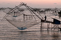 Shore-operated lift net, before the sunrise, Phatthalung, Southern Thailand.