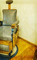 Old barber´s chair - waiting for a customer ... left in a quiet corner to be viewed but not used. South Africa.