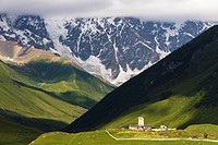 Lamaria church and tower in huge Caucasus mountains background. Ushguli, the highest permanently inhabited village in Europe. Svaneti, Georgia.