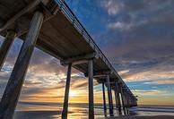 Scripps Pier, clouds, sunset, upward view. La Jolla, California, United States.