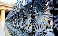 Palm-like wrought-iron fence. Park Güell, Barcelona, Spain