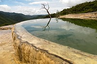 Hierve el Agua is a natural setting between the mountains of San Lorenzo Albarradas, Oaxaca, 22 kms from the archaeological site of Mitla, where multi...