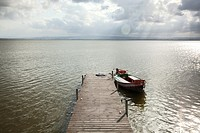 Wood dock with a old boat at the Albufera, Valencia. Spain.