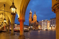 Night falls at the Cloth Hall in Krakow old town, Poland. Looking towards St Mary´s church. UNESCO world heritage site.