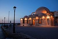 Hassan Pasha Mosque at the Venetian harbor near the sea by night, Chania, Crete, Greek Islands; Greece, Europe.