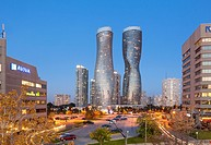 Absolute World Towers 4 & 5 (The Marilyn Monroe Towers) at dusk. Mississauga, Peel Region, Ontario, Canada.