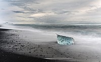 icebergs on black volcanic beach. Beach of the north atlantic near the glacial lagoon Joekulsarlon and glacier Breithamerkurjoekull in the Vatnajoekul...