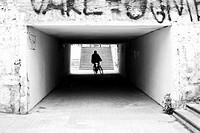 Silhouette of people crossing a sidewalk tunnel. Valencia, Spain.