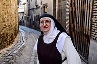 Nun in the old quarter, Toledo.