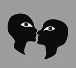 A couple about to kiss, looking at the viewer.