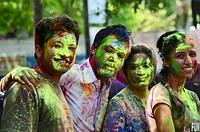 Colorful faces of boys and girls playing Holi (Festival of Colours), Pune, Maharashtra, India.