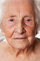 frontal view of the face of an elderly woman.