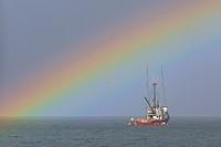 Fishing boat and rainbow, near Nanaimo, Vancouver Island, British Columbia.