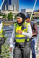 Muslim female police officer wearing her religious headress whilst on duty in London.
