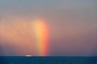 Rainbow over Baltic Sea and cruise ship, Europe.