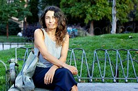Madrid, Spain, woman relaxing, sitting on a bench at Plaza Espana in Madrid. She´s a spanish english translator and has her own business