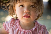 Dreamy expression of two year old toddler girl.