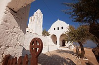 Framed view to the Panagia Kimissis church by the cliff, Folegandros, Cyclades Islands, Greek Islands, Greece, Europe