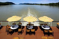 tourism, holiday, freetime, Danube river cruise, Danube navigation, open afterdeck on an aROSA cruiser, restaurant, dishes, chairs, sunshades, river l...