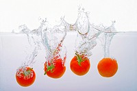 Tomatoes thrown into water.