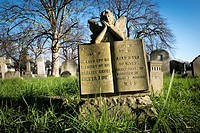 Surface level view of grass and tombstones. Brompton Cemetery, Fulham Road, London, England