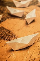 Toned image of nautical paper boat vessels and navigational equipment. world traveling concept.