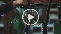 Craftsman drilling metal with drill in workshop