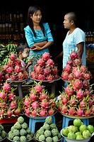 Myanmar, Mount Popa, Taung Kalat village, Fruit market, Dragon fruit and custard apple.
