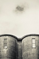 Exterior of old industrial building. Concrete architecture. Abandoned factory.