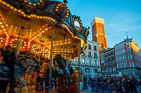 Christmas carousel at Santa Cruz Square. Madrid, Spain.