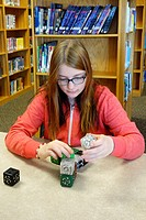 7th Grade Girl Working With Robot Cubes, Wellsville, New York, USA.