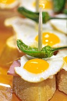Fried eggs with Green pepper. Pintxos or Tapas. Food very Typical in the Basque country. San Sebastián (Donostia), Gipuzkoa, Basque Country, Spain