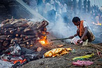 Cremation of a body, in Manikarnika Ghat, the burning ghat, on the banks of Ganges river, Varanasi, Uttar Pradesh, India.