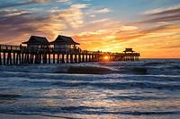 Winter sunset over the Naples Pier, Naples, Florida, USA.