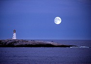 large moon over peggy's cove lighthouse in nova scotia.