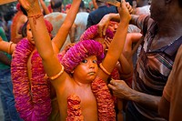 DHAKA, BANGLADESH - APRIL 13 : Hindu devotees dance as they take part in a festival called Lal Kach (Red Glass) during the last day of the Bangla mont...